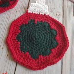 Tree Ornament Crochet Coaster. One coaster, in bauble shape crafted in red with black center and white top    thecrochetspace.com