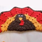 Turkey Crocheted Place Mat. Turkey face in the center with plumage surround || thecrochetspace.com