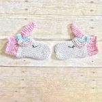 Unique Unicorn Crochet Mittens. The horn and cuffs are crafted in pink. The horn is where the thumb sits    thecrochetspace.com
