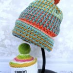 Uniquely Textured Crochet Hat. Hat on a hat stand || thecrochetspace.com