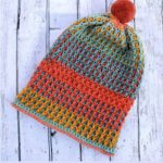 Uniquely Textured Crochet Hat. Hat laid out on decking || thecrochetspace.com