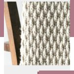 Winter Crochet Montane Afghan. Folded over the back of a chair and crafted in a neutral color || Chunky afghan crafted in neutral color || thecrochetspace.com