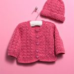 Winter Wonder Crochet Set. Cardigan on hanger with hat separate. Crafted in dark pink || thcrochetspace.com